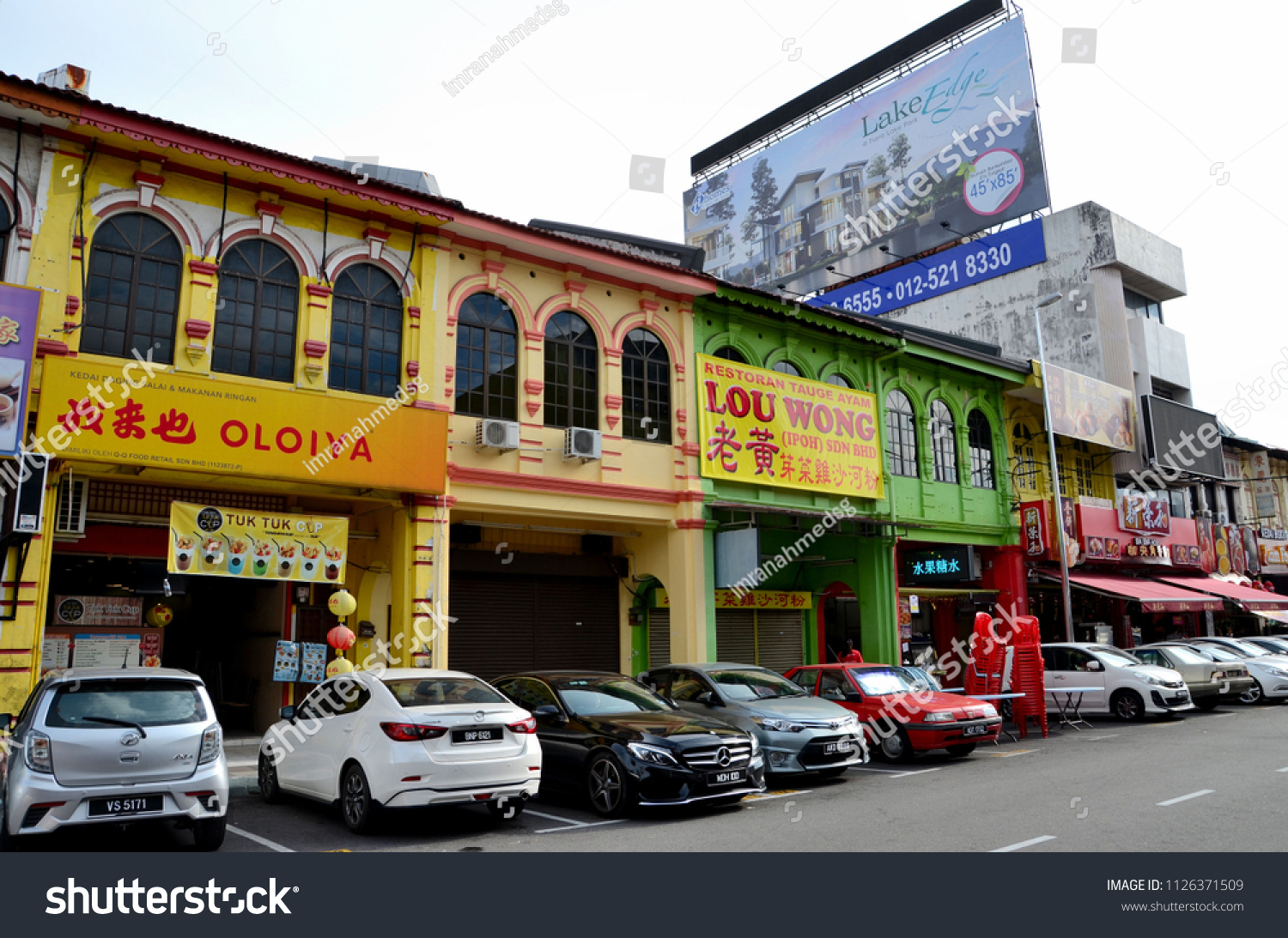 Ipoh, Malaysia - June 4, 2017: Cars parked outside restaurants, food stalls