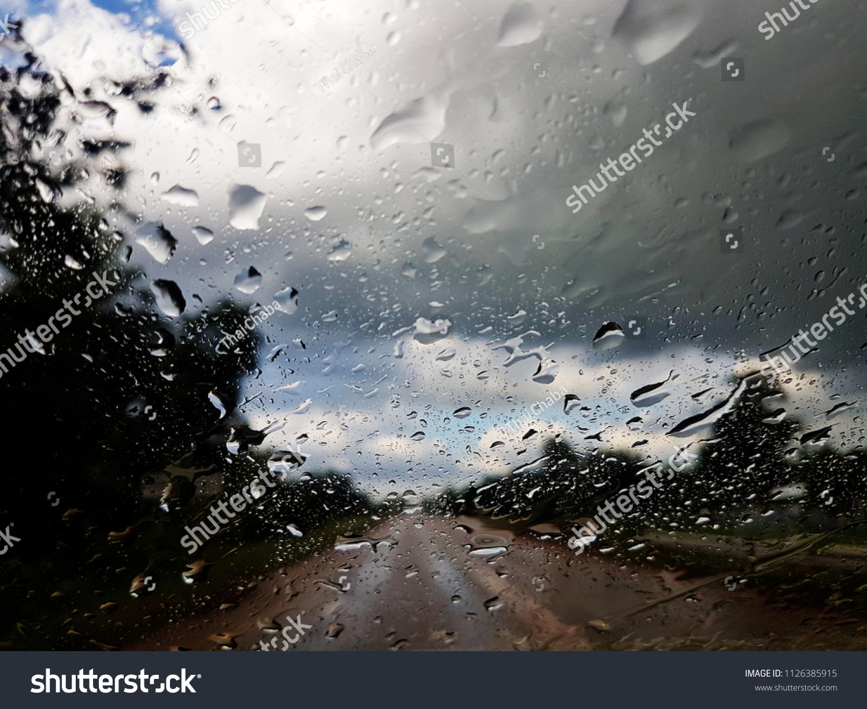 Rain On Glass Background Bokeh Colorful Stock Photo Edit
