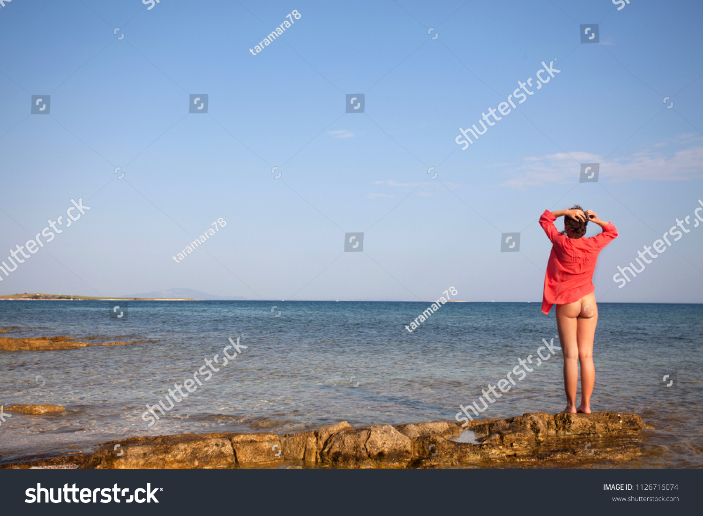 Half naked woman on beach