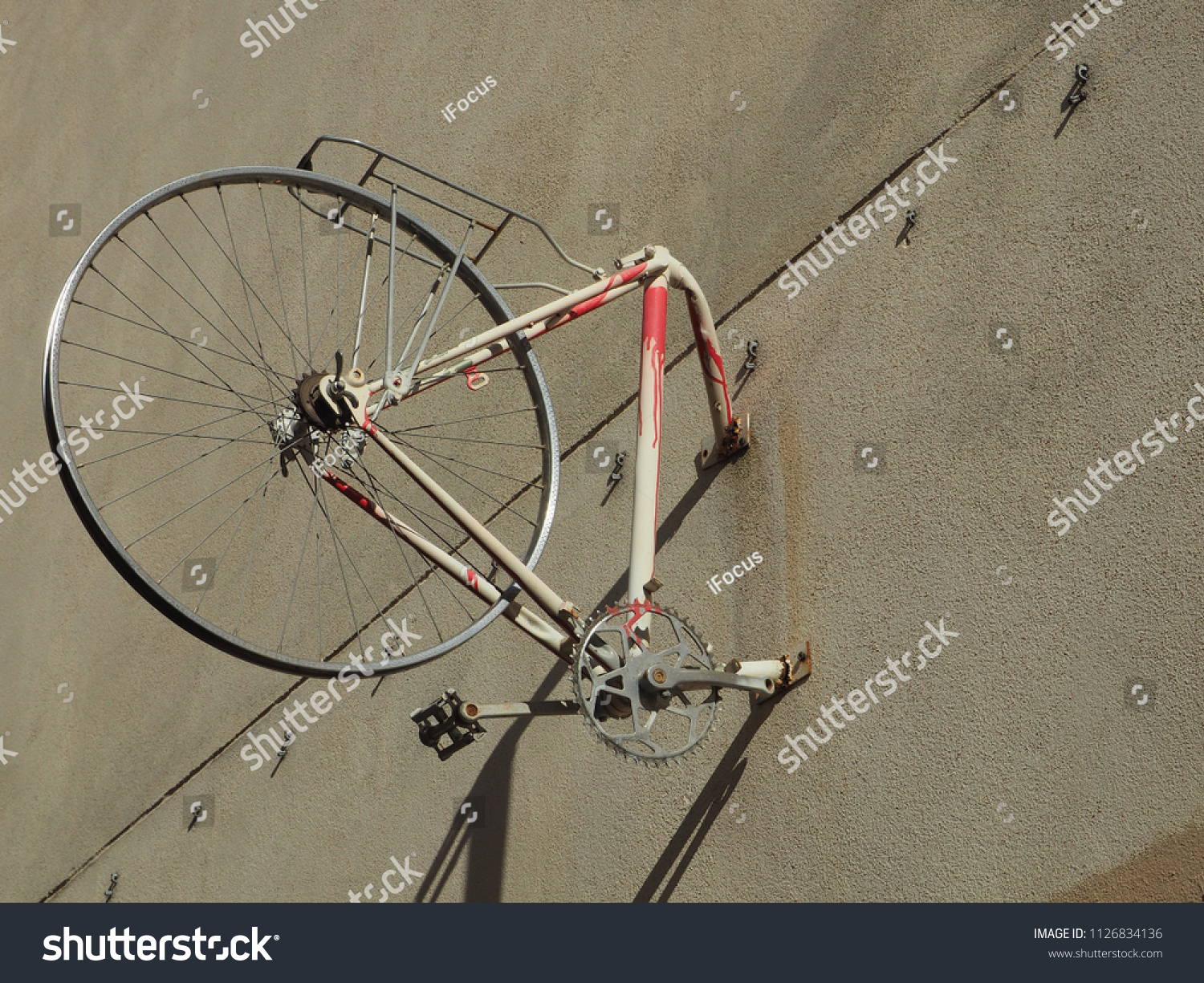 PARIS, FRANCE - JULY 3, 2018: Street art bike on a wall in the 11th district -arrondissement- of French capital, on July 3, 2018 in Paris, France.