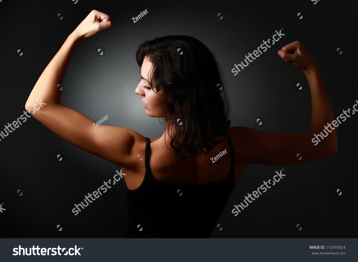 Strong Woman Demonstrating Her Muscles Arms Stock Photo Edit Now