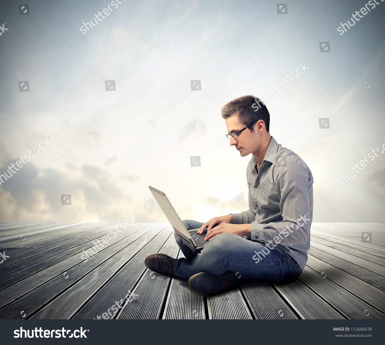 Man Using His Laptop Computer Stock Photo 112696078