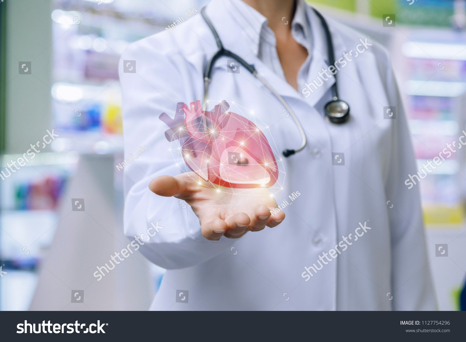Doctor shows heart in his hand . The concept of treatment of the cardiovascular system. #1127754296