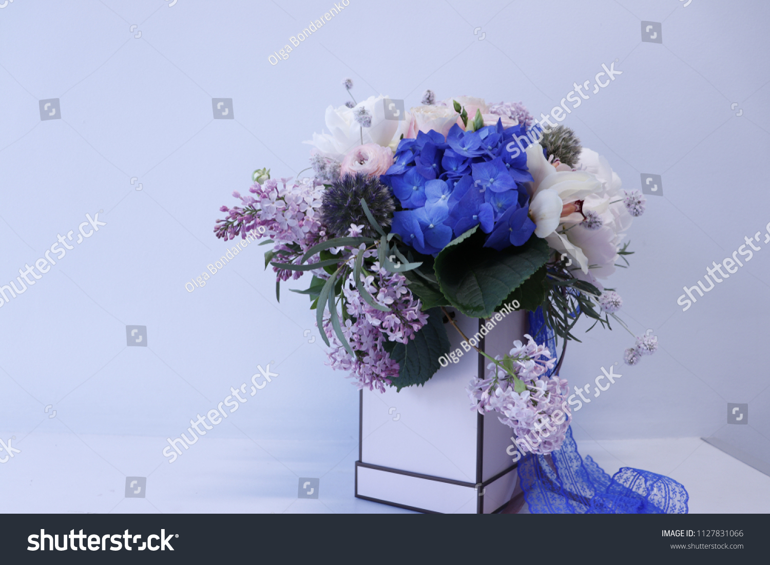 Flower Arrangement Blue Hydrangeas Orchids High Stock Photo Edit Now 1127831066