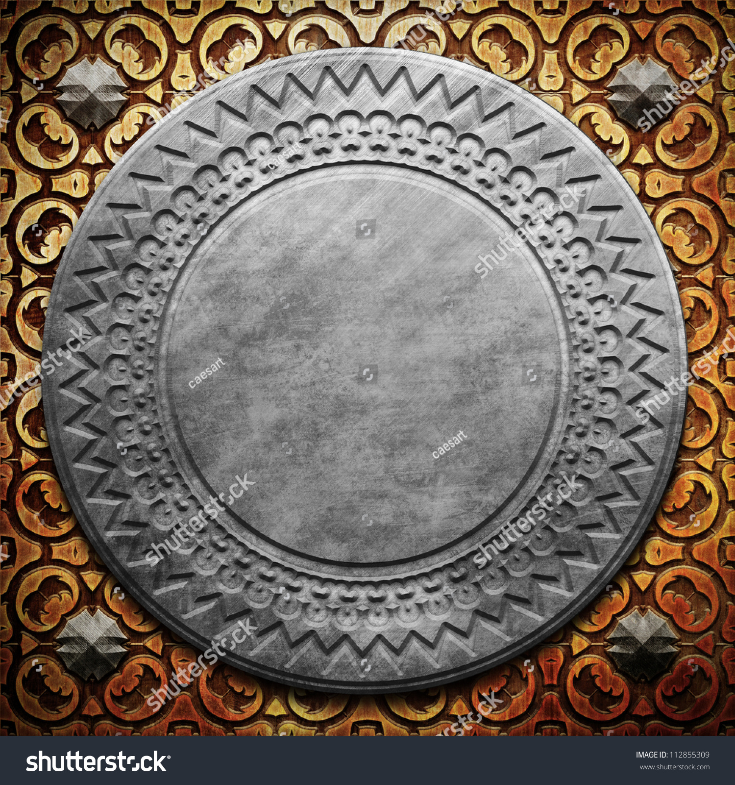 Round metal plate on carved wooden background stock photo