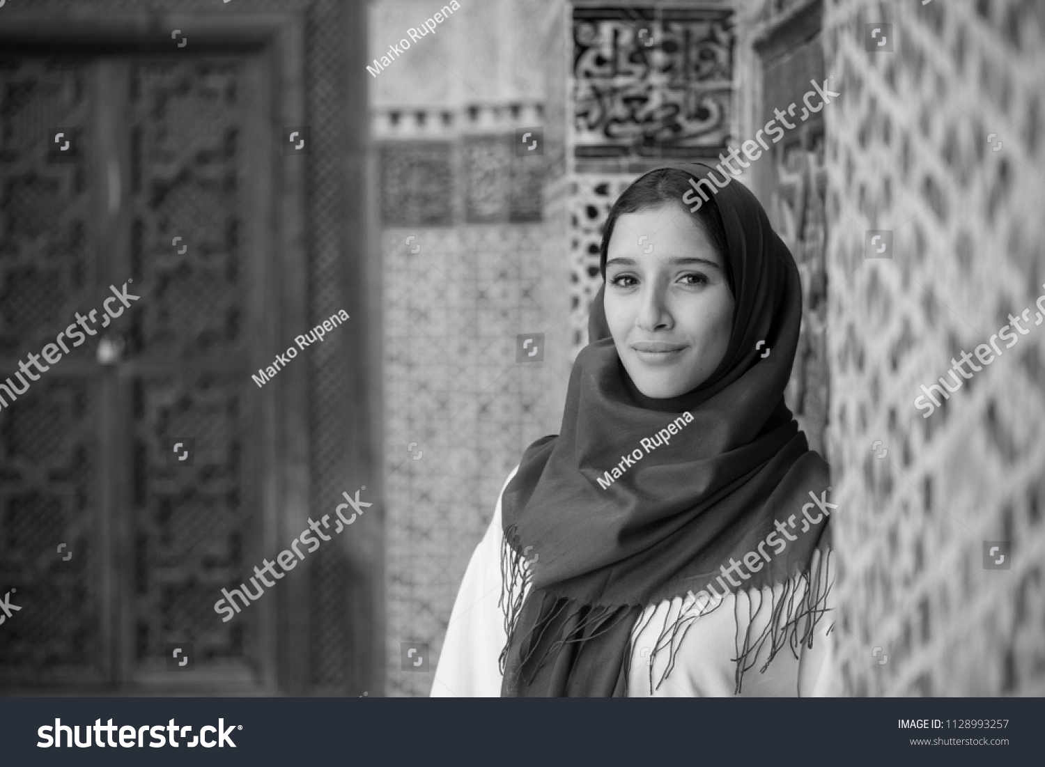 Black and white portrait of arab woman in traditional clothing with hijab on her head