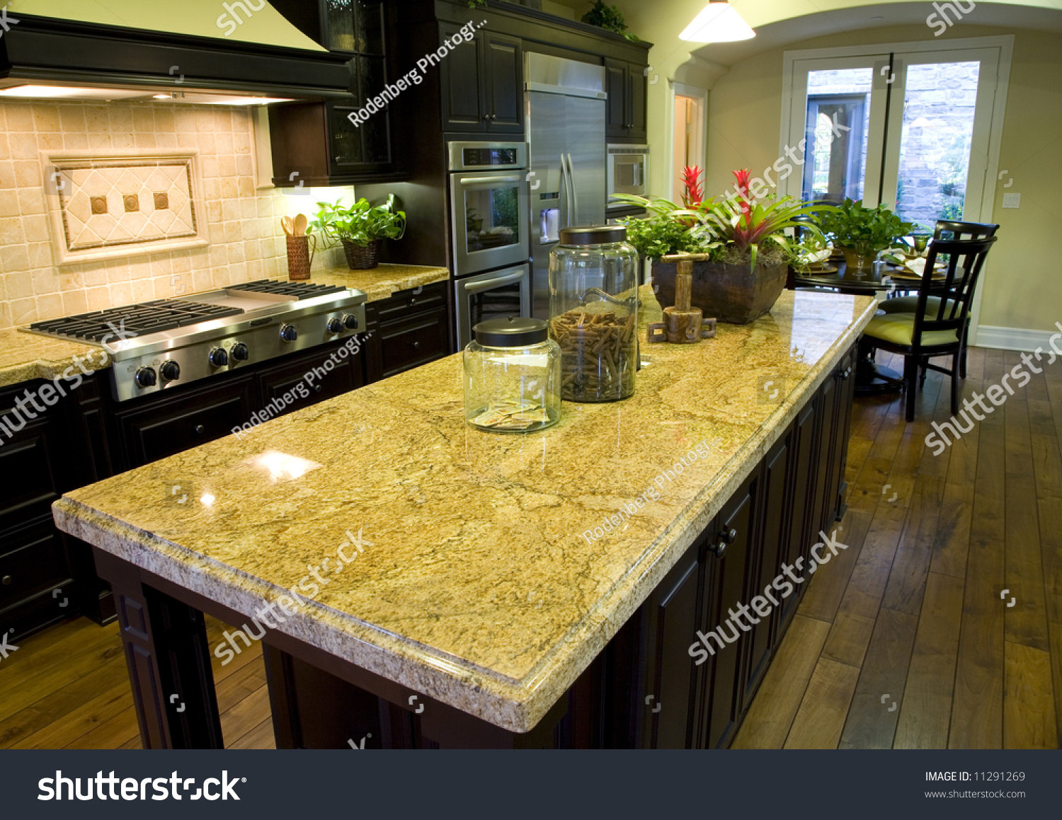 Luxury kitchen hardwood floor granite island stock photo Luxury kitchen flooring