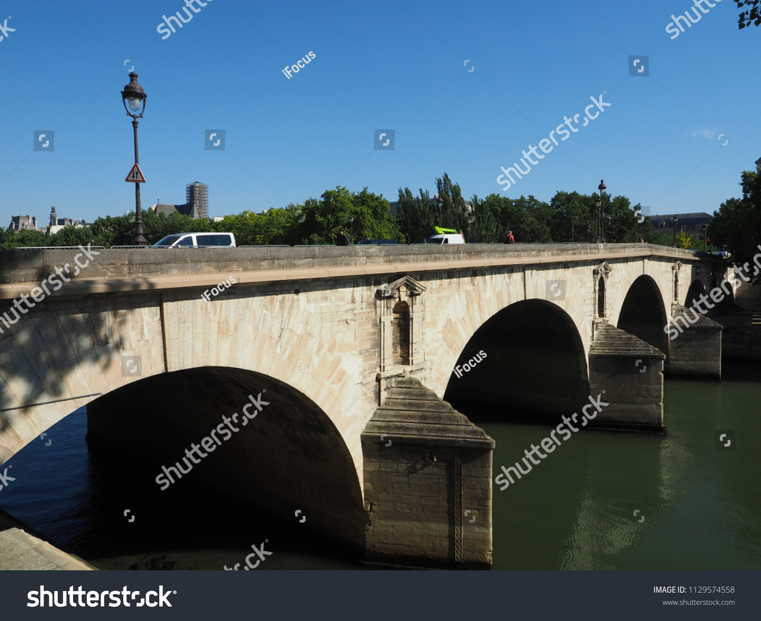 PARIS, FRANCE - JUNE 28, 2018: Pedestrians and vehicles use Pont Marie to cross River Seine on June 28, 2018 in Paris, France.