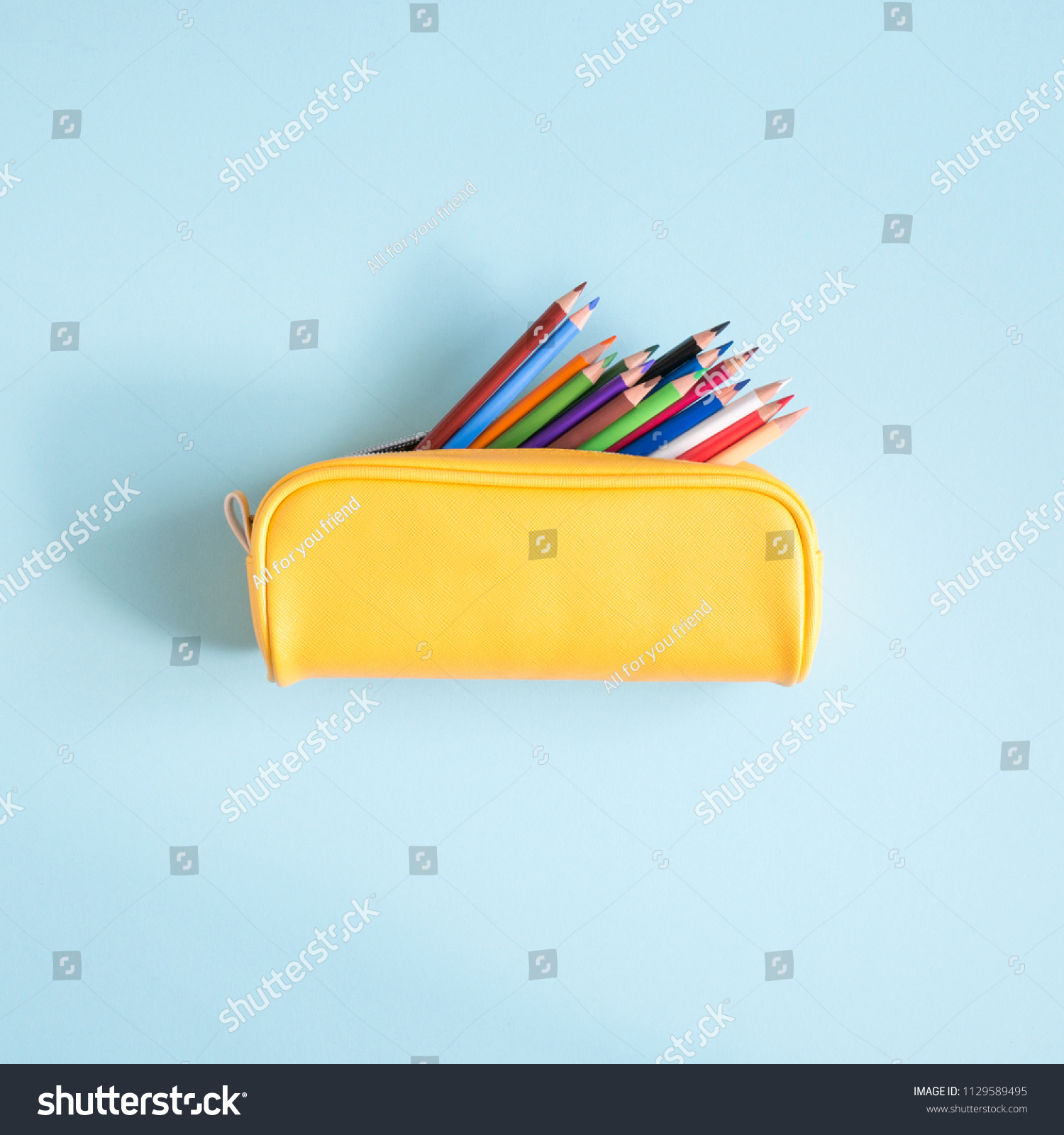 Colored different school supplies on soft  blue paper background. Back to school background. Flat lay, top view, copy space #1129589495