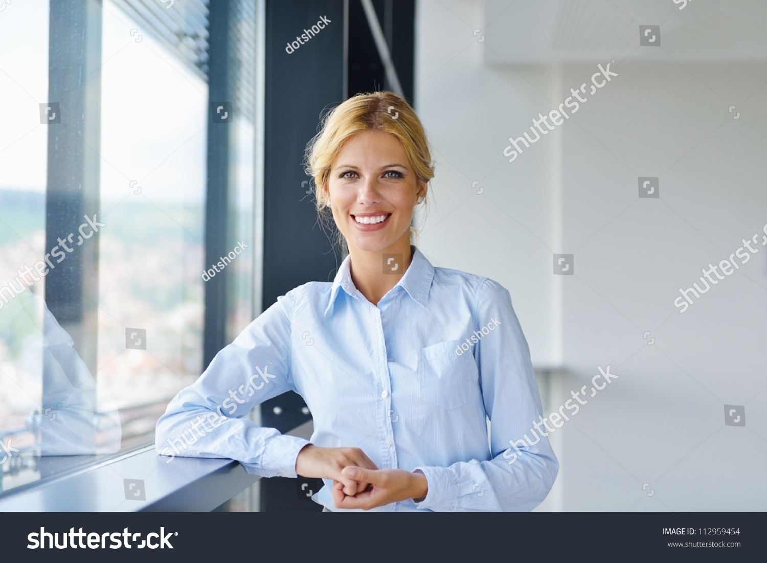 Young pretty business woman with notebook in the bright modern office indoors #112959454