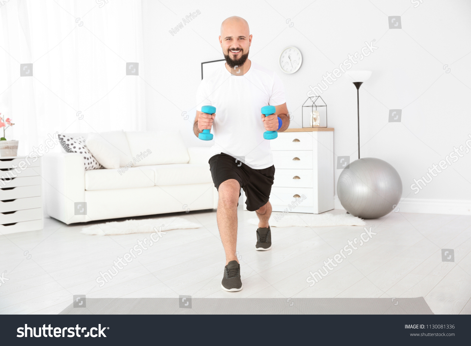 Overweight man doing exercise dumbbells home stock photo edit now