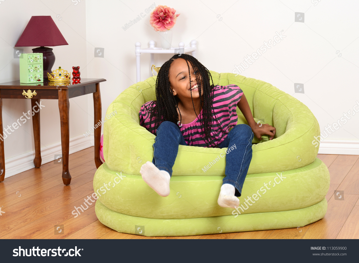 Black child sitting in chair - Young Black Child Trying To Get Out Of Chair