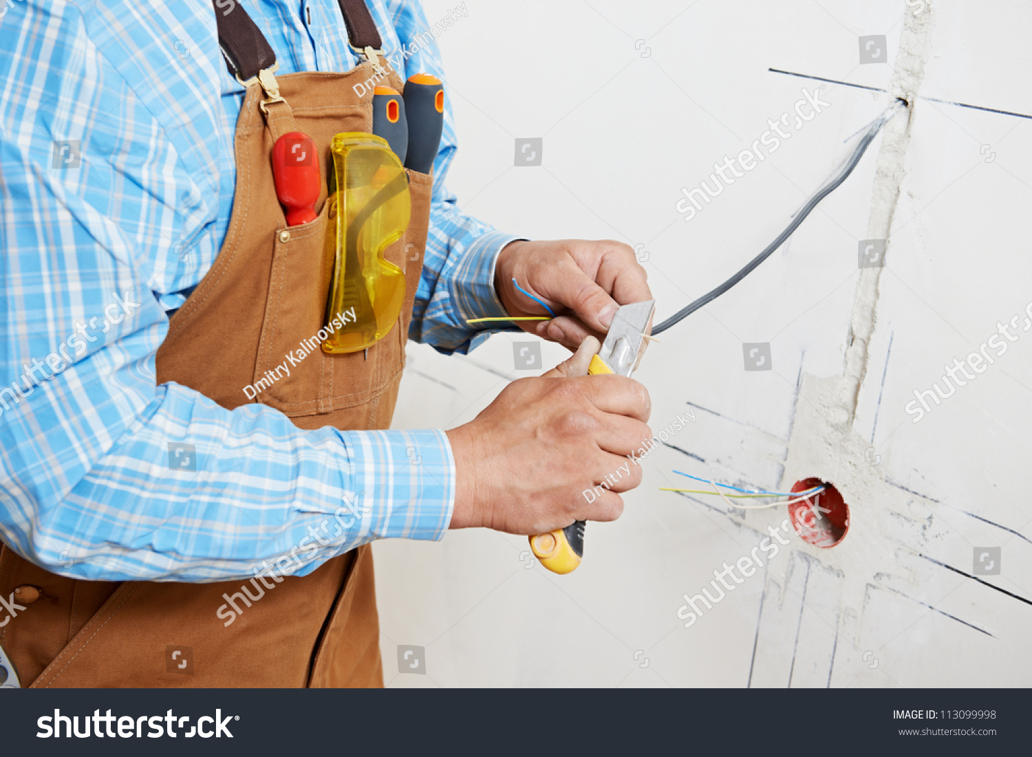 Closeup Electrician Worker Hands Wiring Cable Stock Photo Edit Now A Switched Wall Outlet Close Up Of At And Light Switch Or Power