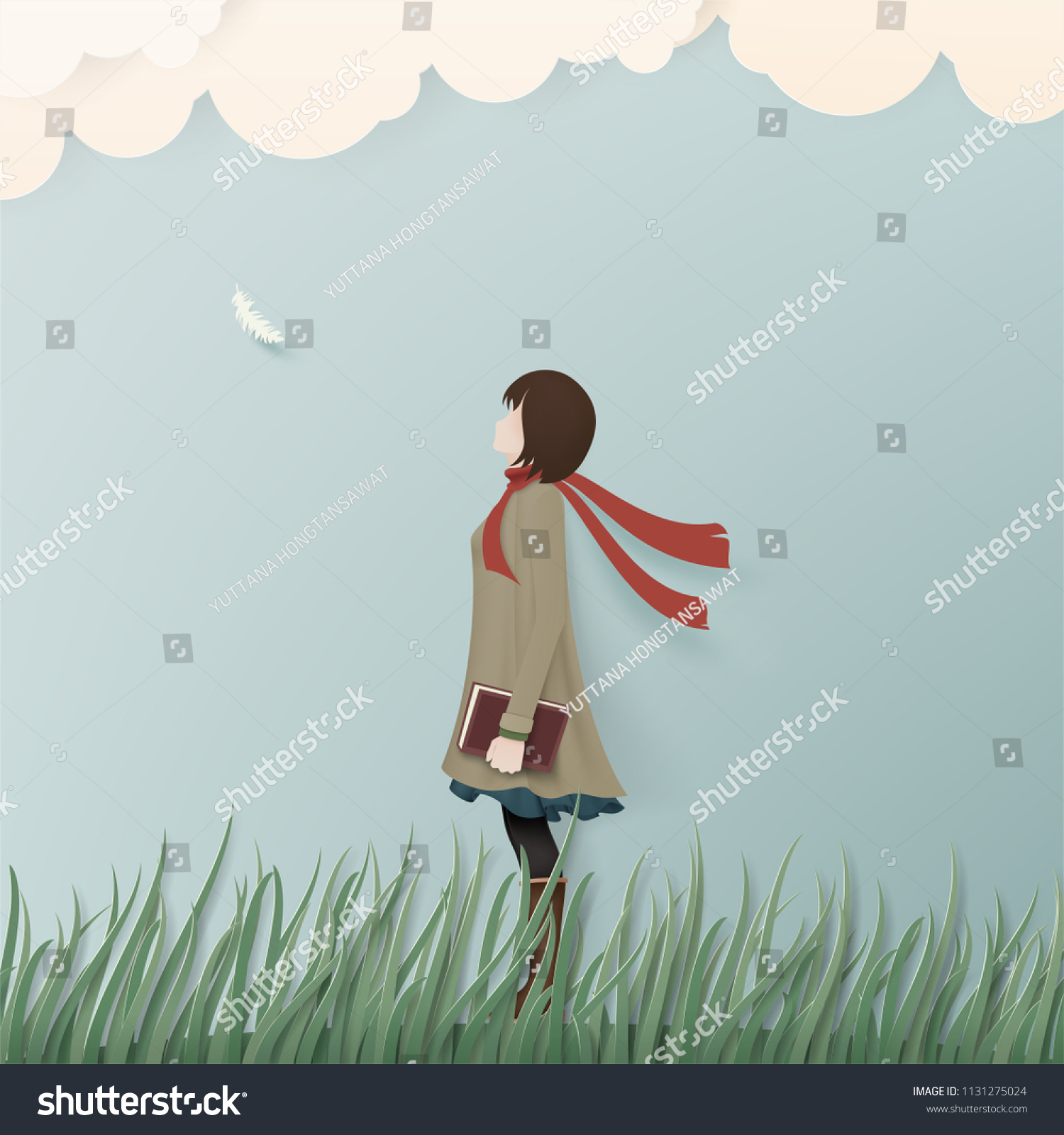 Alone girl in winter coat on green grass with book paper art concept background