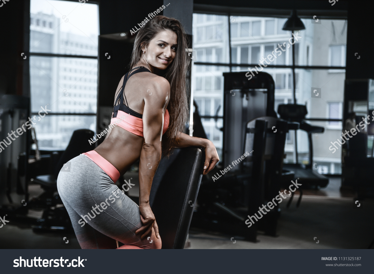 c27ce14d86779 Beautiful strong sexy athletic young caucasian fitness girl with long hair workout  training in the gym