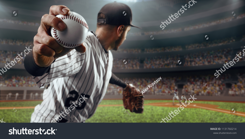 Baseball player throws the ball on professional baseball stadium #1131760214