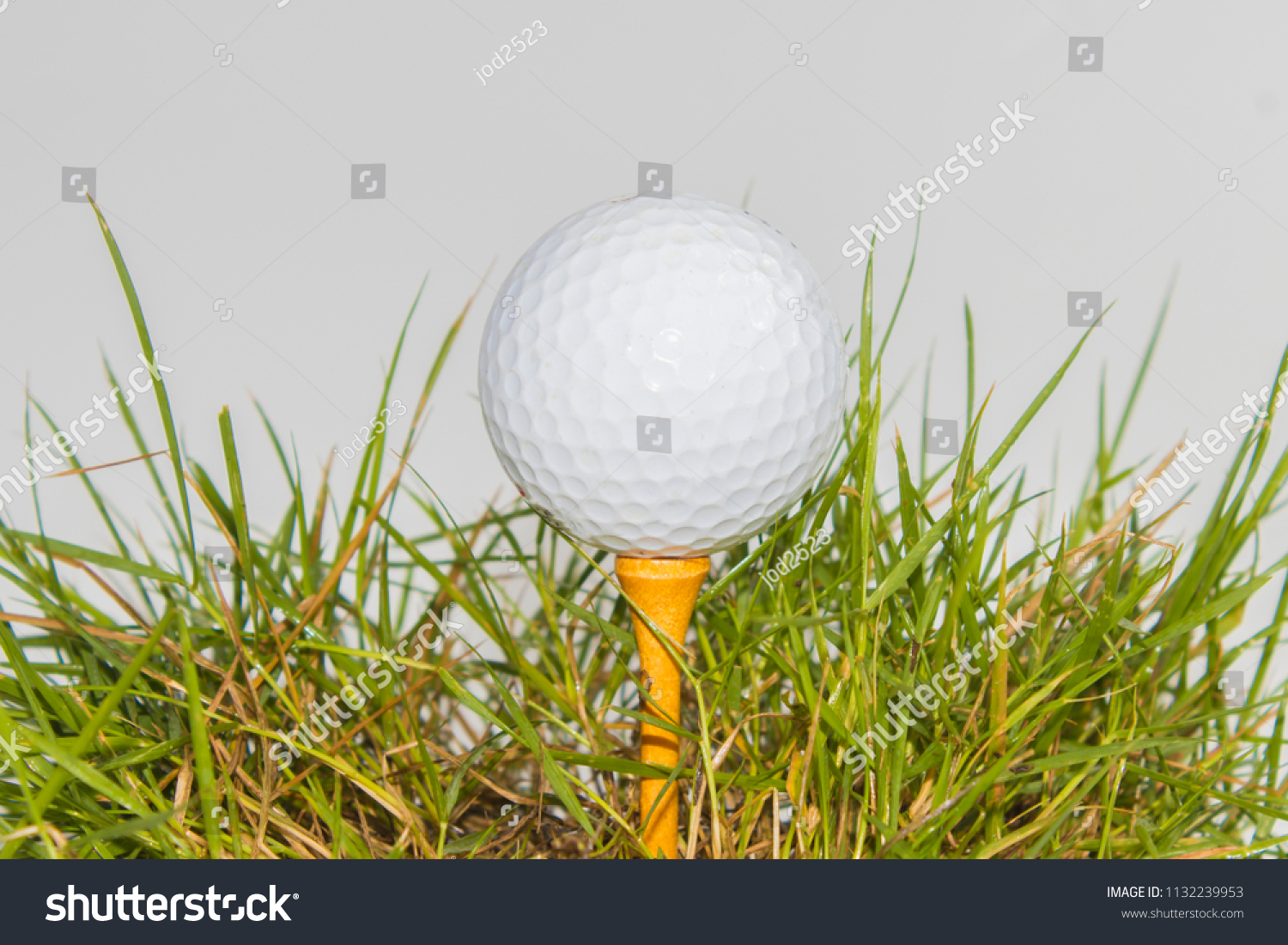 6b9751e8a7c8 Golf balls on pins With grass which are concept Sport poster or website  design