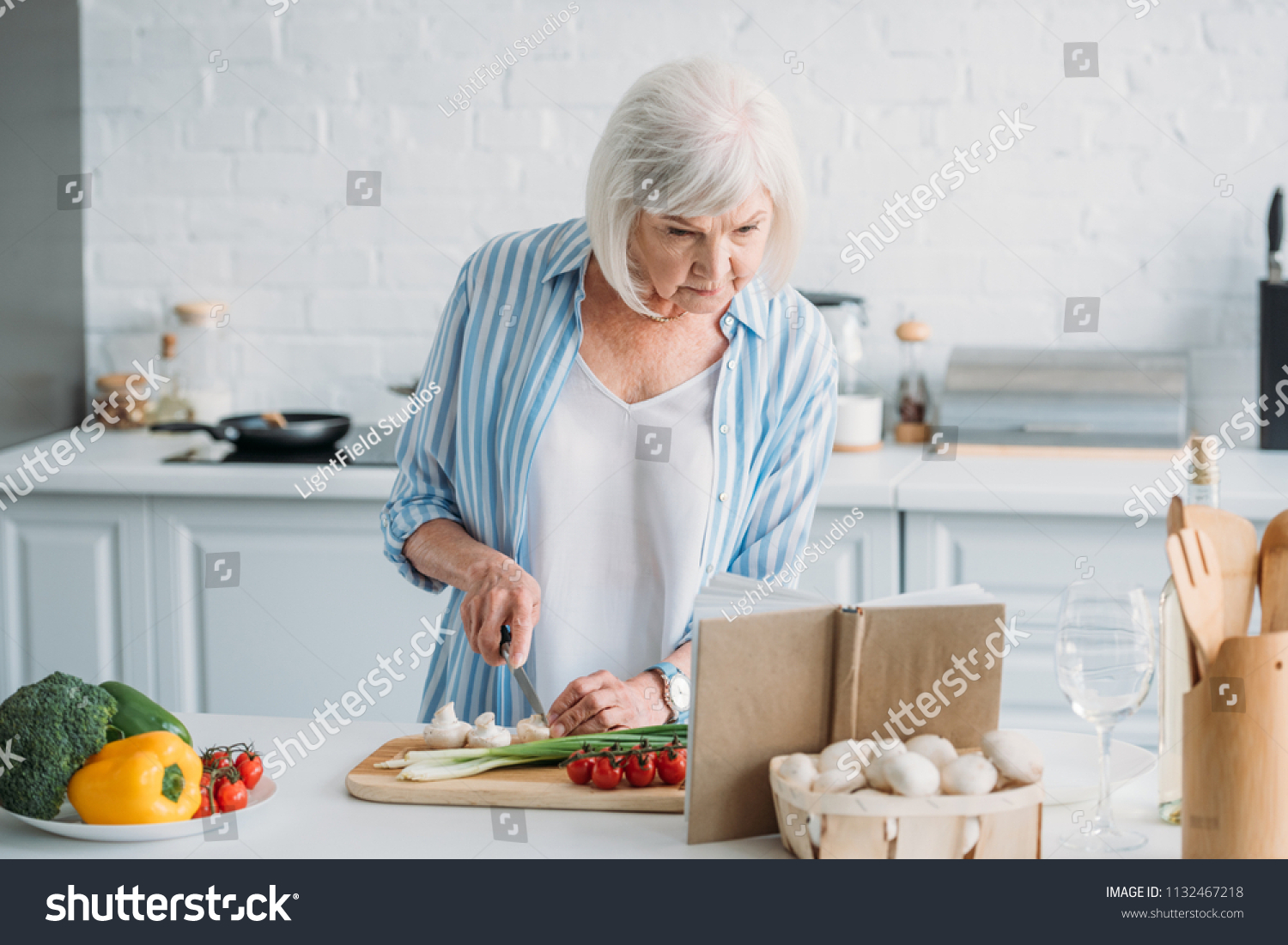 Portrait Senior Lady Looking Recipe Cookery Stock Photo (Safe to Use ...