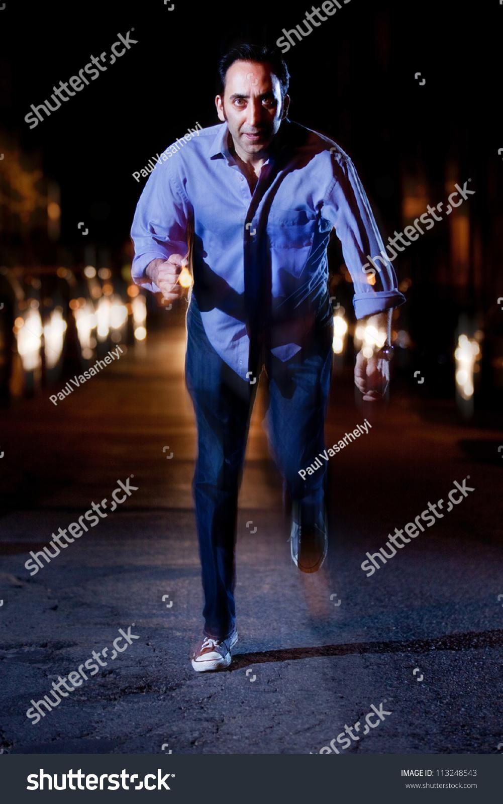 Man running away at night