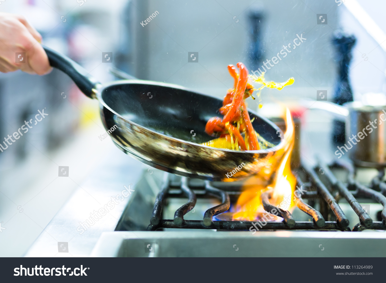 Royalty-free Chef in restaurant kitchen at stove… #113264989 Stock ...