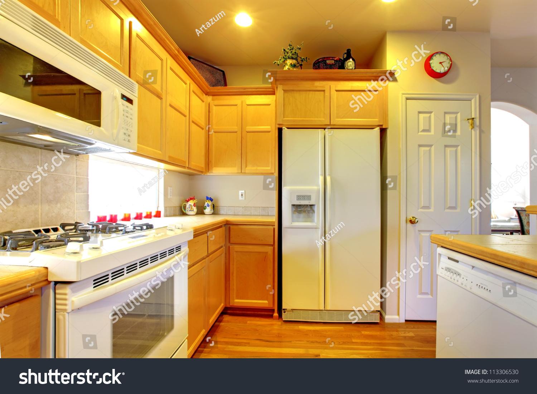 White Appliances In Kitchen Kitchen Yellow Wood Cabinets White Appliances Stock Photo