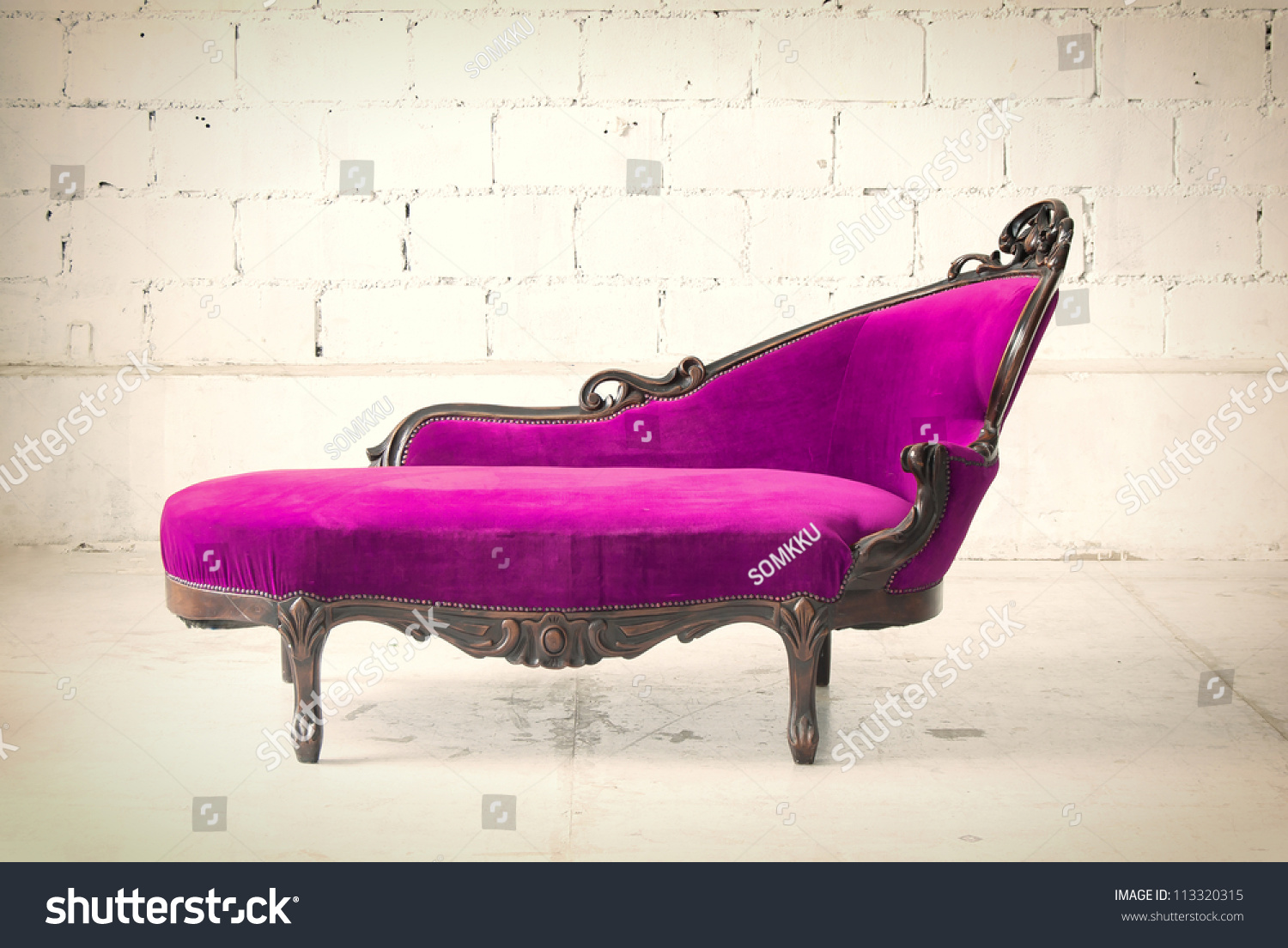 vintage luxury pink sofa isolated in white room stock photo