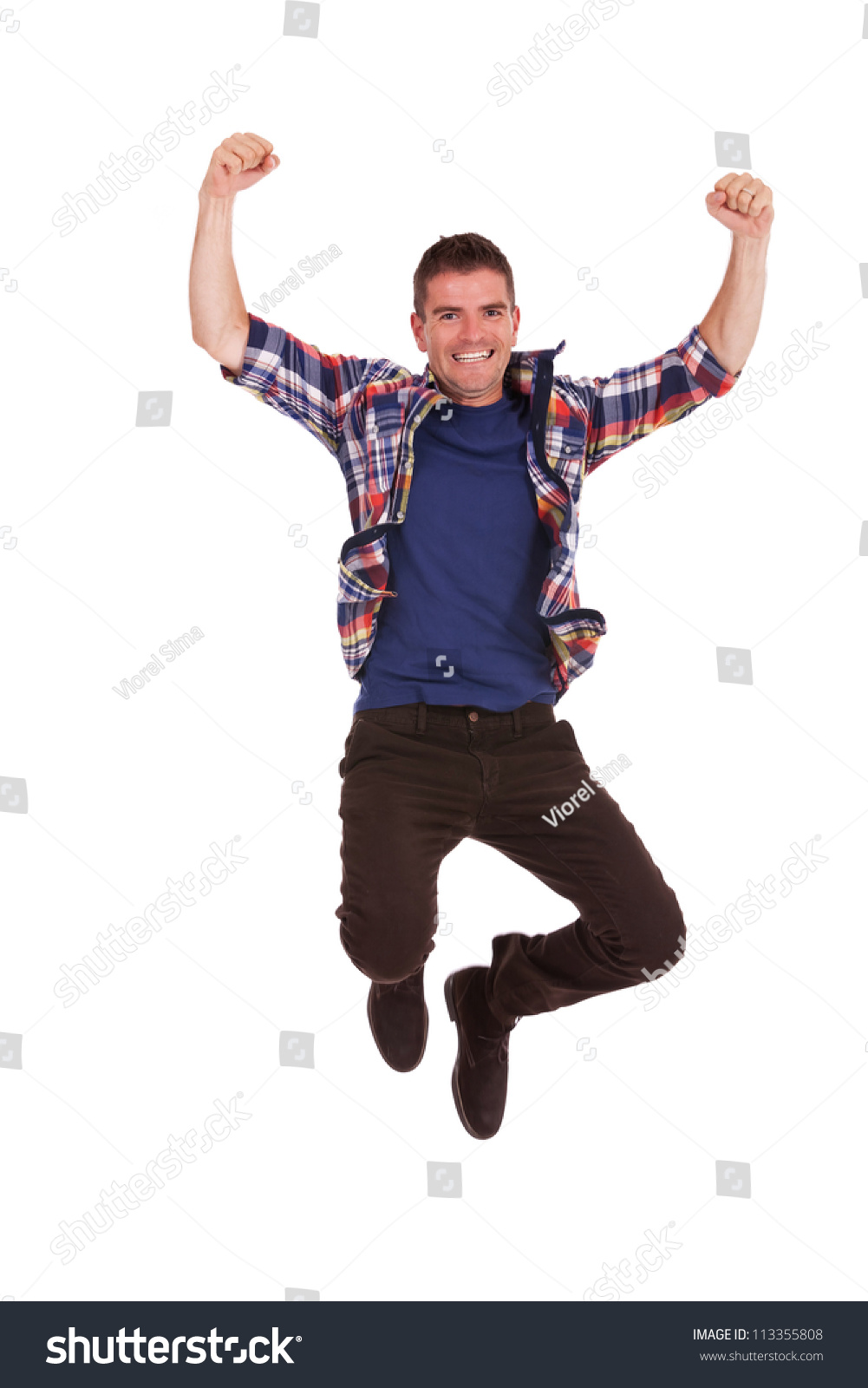 an attractive young man jumping in the air isolated on a
