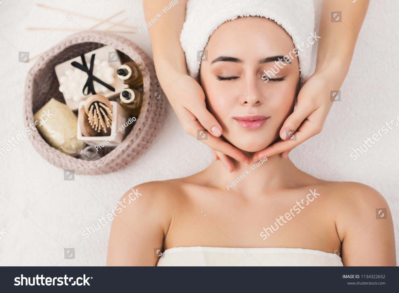 Woman Enjoying Anti Aging Facial Massage Stock Photo Edit Now