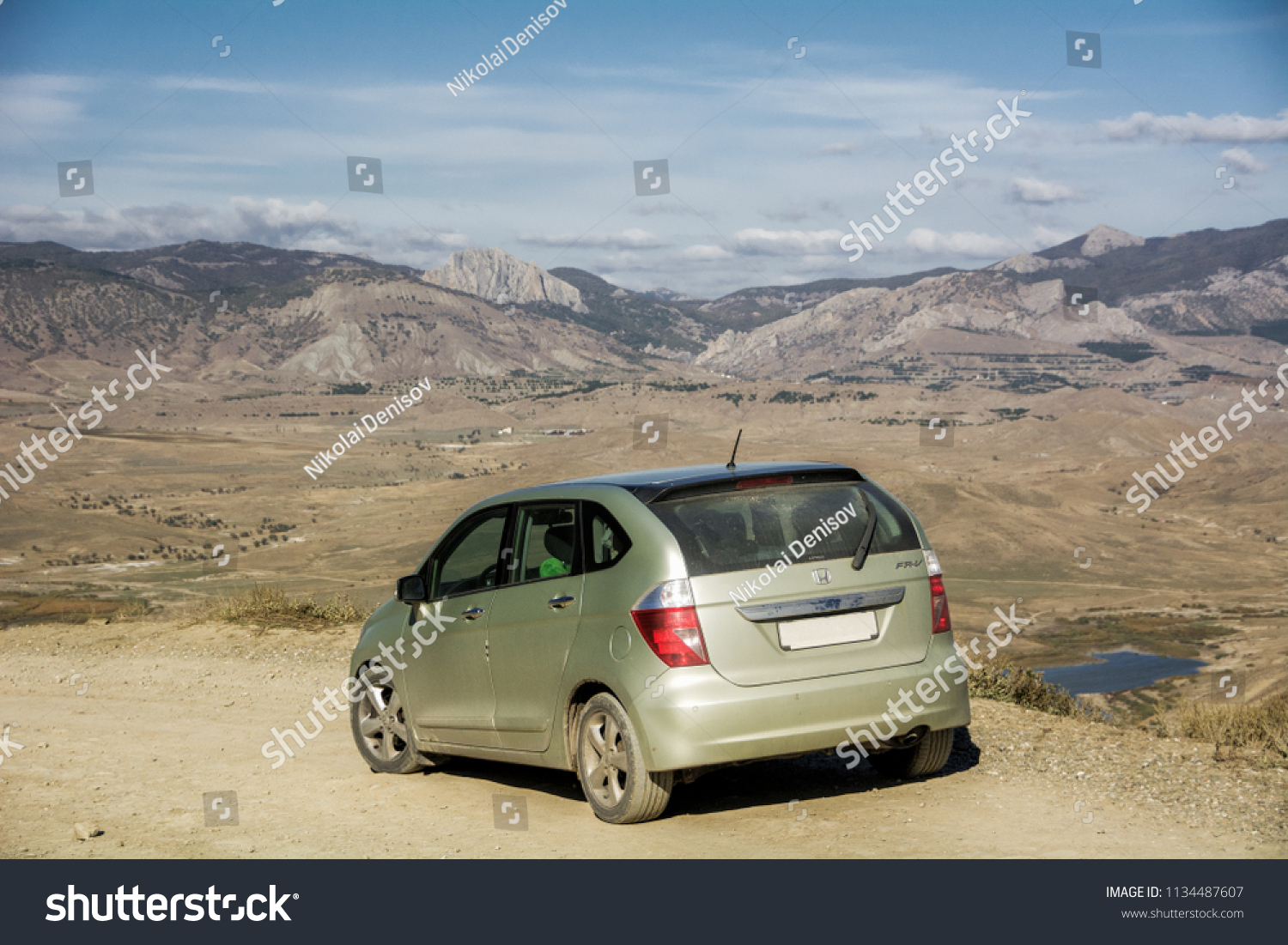 Honda FR-V. The car is parked on a mountain Meganom near wind turbines. Republic of Crimea. October 30, 2015. #1134487607