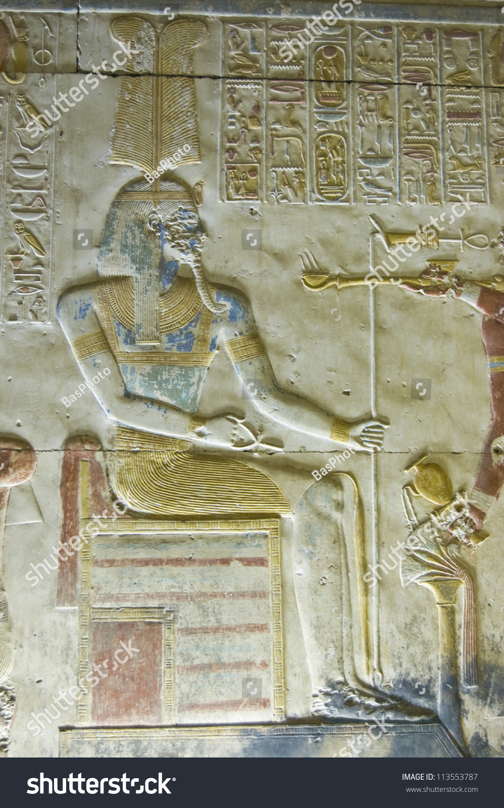 Bas relief carving of the ancient egyptian god amun