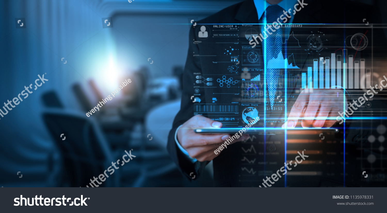 Intelligence (BI) and business analytics (BA) with key performance indicators (KPI) dashboard concept.Website designer working digital tablet and smart phone. #1135978331