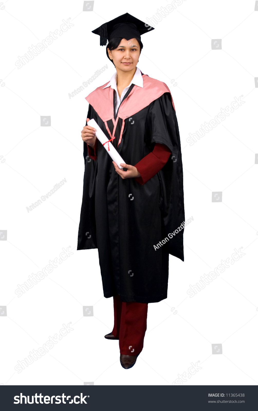 Young woman in black graduation gown hold certificate of degree ...