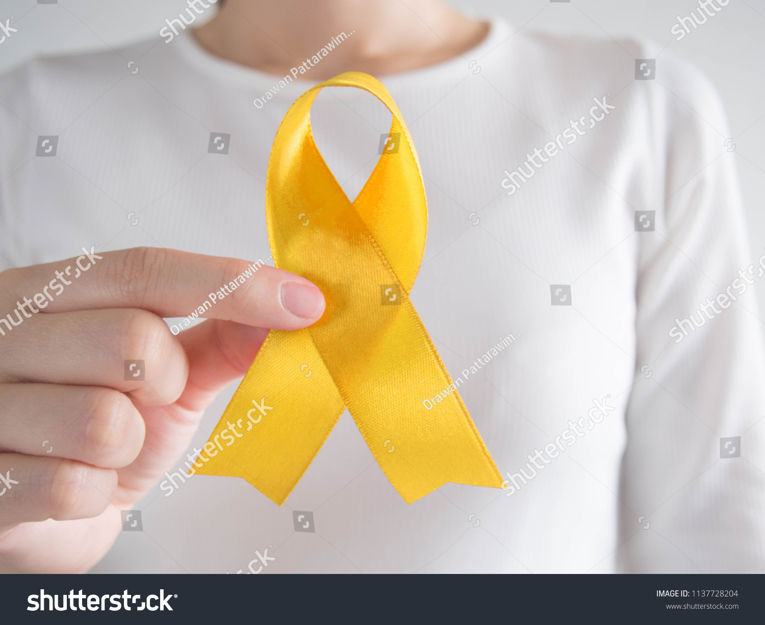 Young Female Holding Yellow Gold Ribbon Stock Photo Edit Now