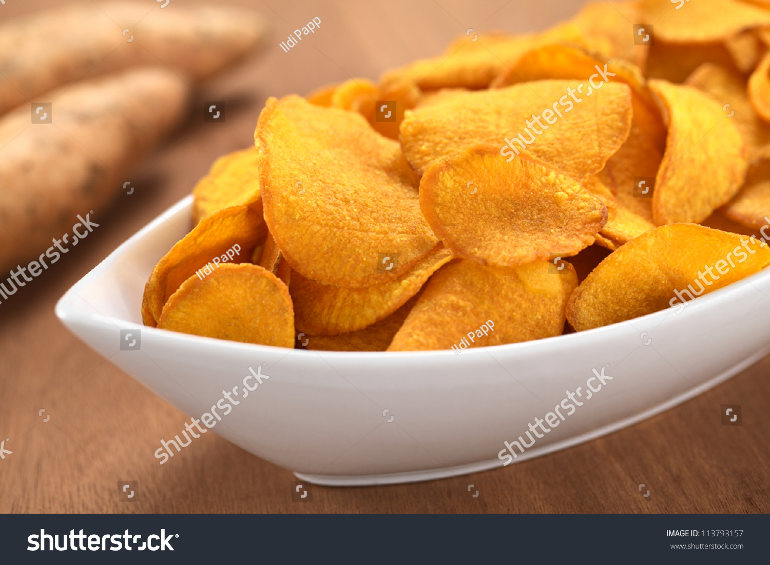 Crispy Peruvian sweet potato chips in white ceramic bowl with sweet ...