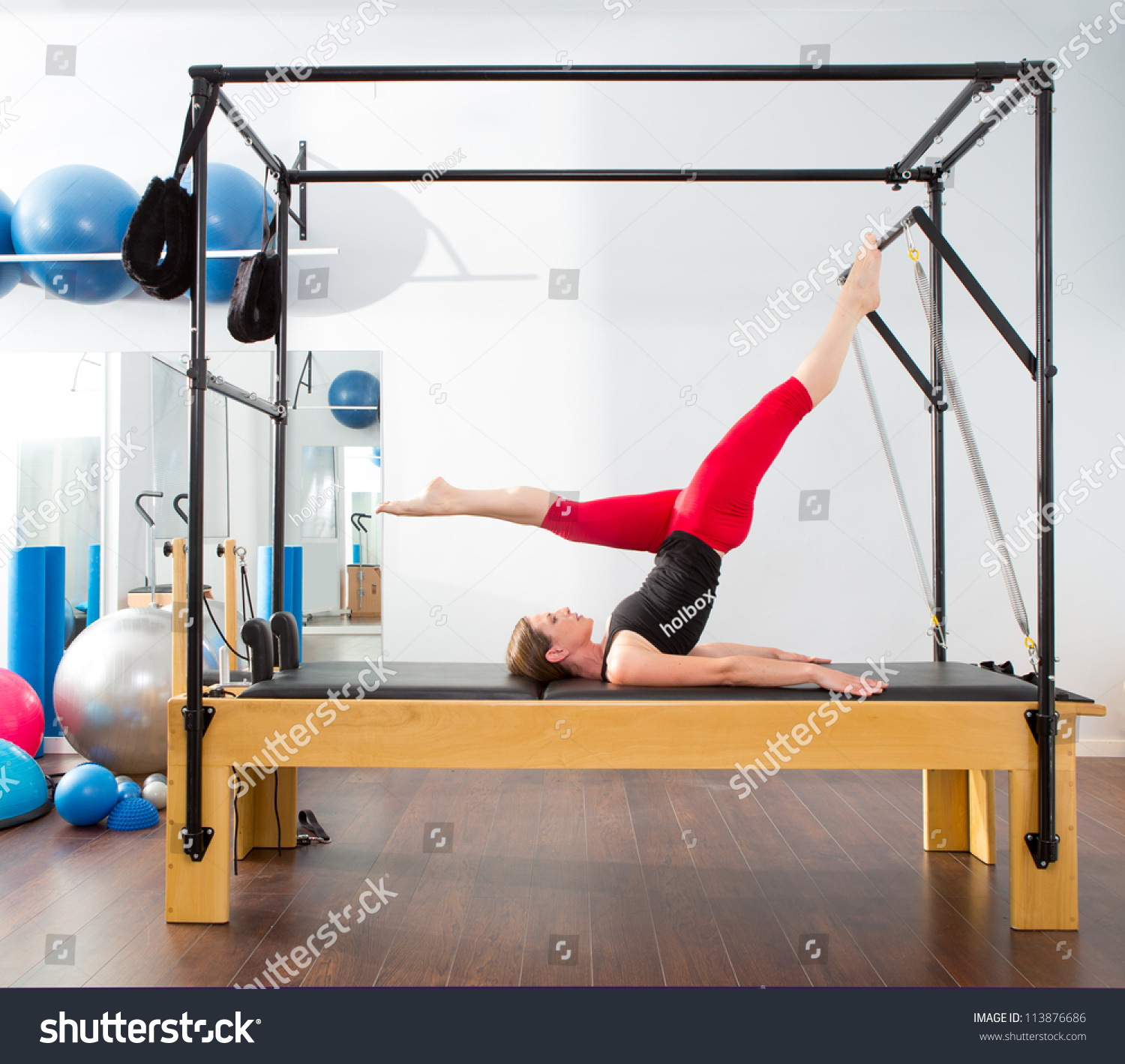 Woman Pilates Chair Exercises Fitness Stock Photo: Pilates Aerobic Instructor Woman Cadillac Fitness Stock