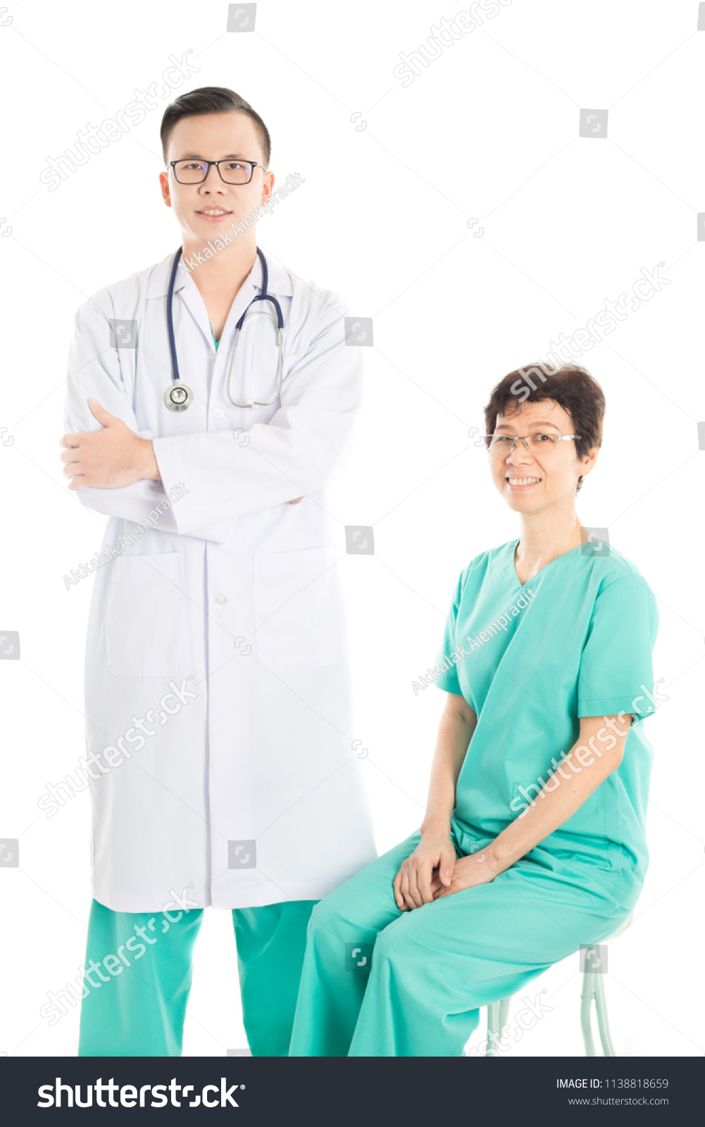 two smart Asian doctor stand on white background, cross one's arm