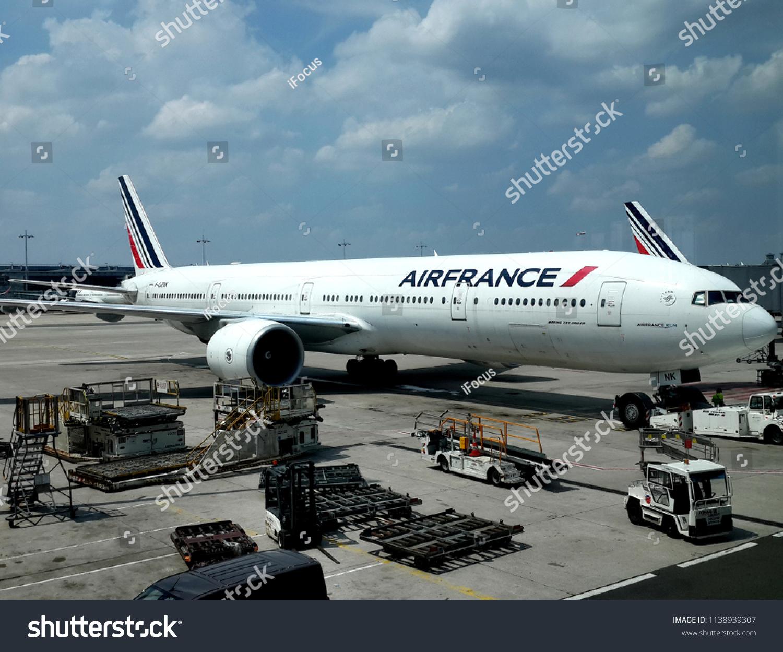 ROISSY-EN-FRANCE, FRANCE - JULY 14, 2018: A Boeing 777-300 ER wearing French national airline Air France's colors is parked at a gate on July 14, 2018 at Roissy-en-France, France.