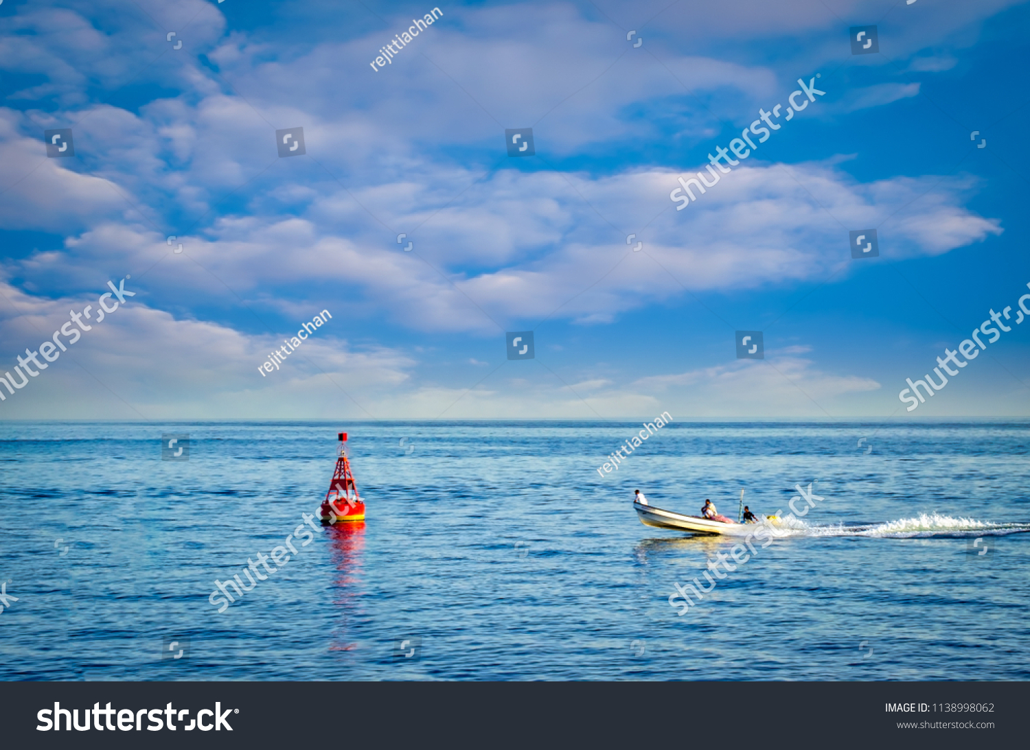 stock-photo-a-fast-fishing-boat-moving-t
