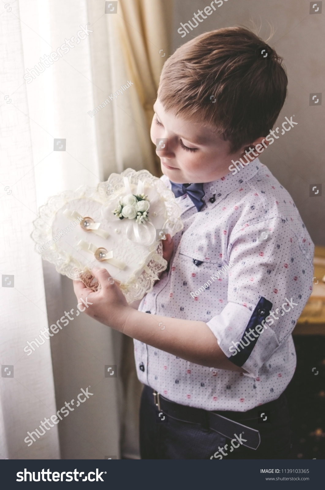 A Little Boy Holds Wedding Rings For The Newlyweds Child And Of: Wedding Band Little Boy At Reisefeber.org