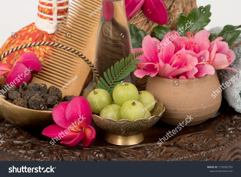 Soak hair indian gooseberry fruits hibiscus stock photo edit now soak hair with indian gooseberry fruits hibiscus flowers and coconut oil for hair care izmirmasajfo