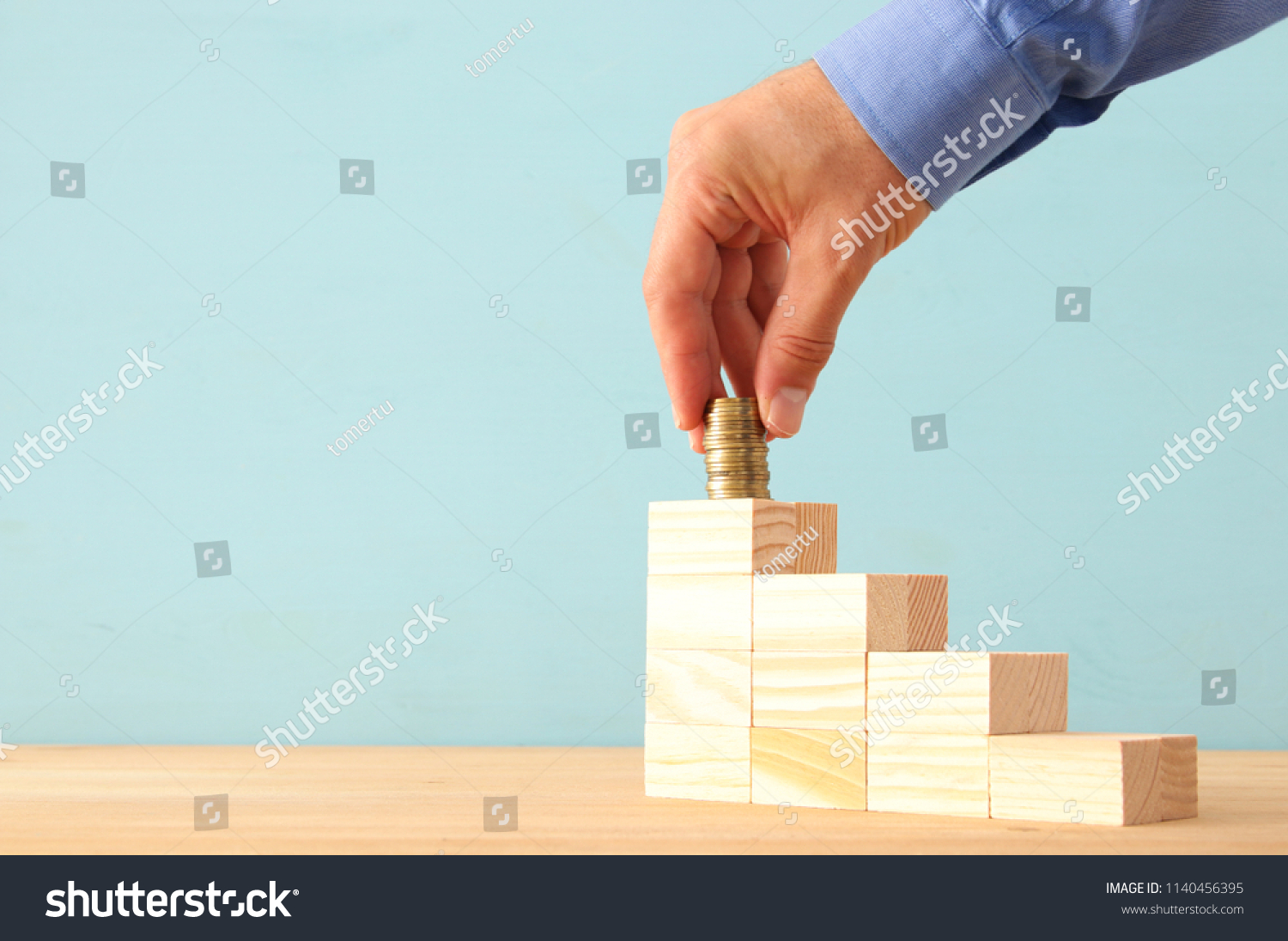 concept image of Saving money or investing. putting stack of coins at the top #1140456395