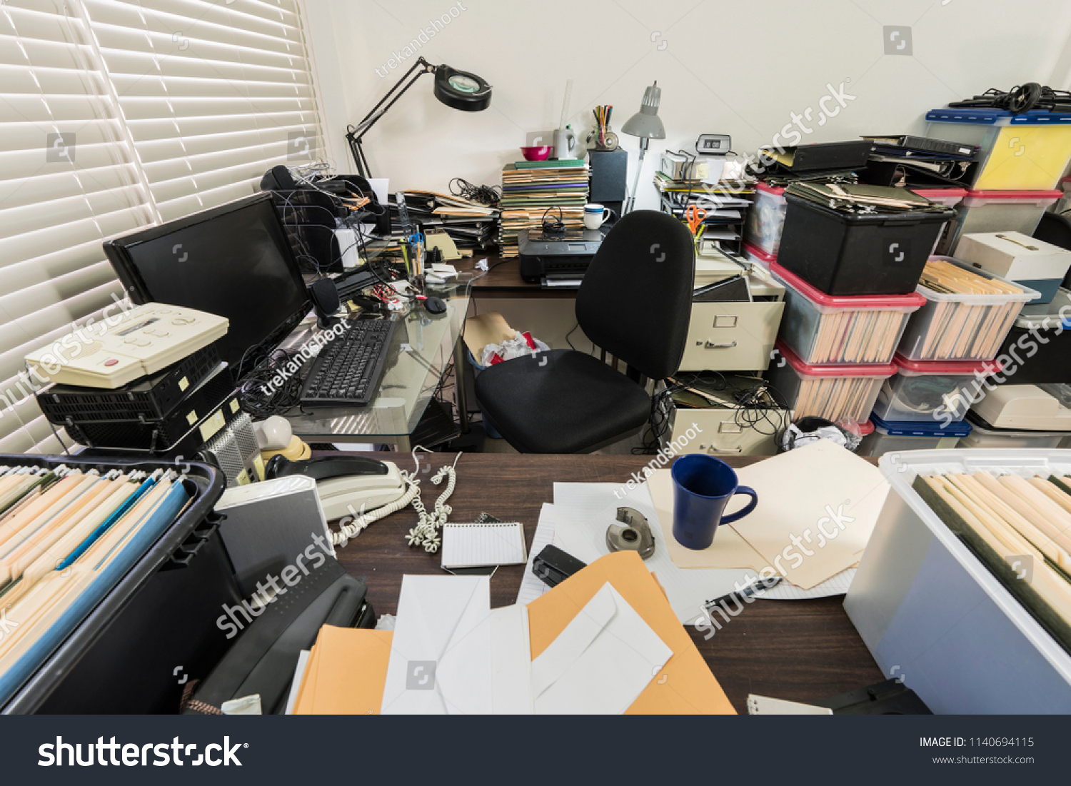 Messy business office with piles of files and disorganized clutter. #1140694115