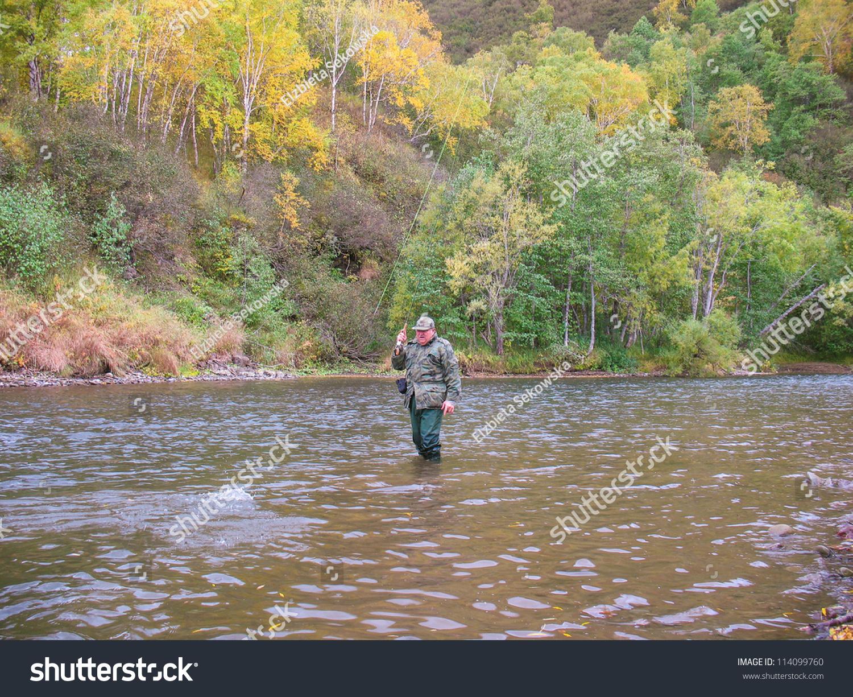 Senior man fishing in raduga river kamchatka russia for Senior fishing license
