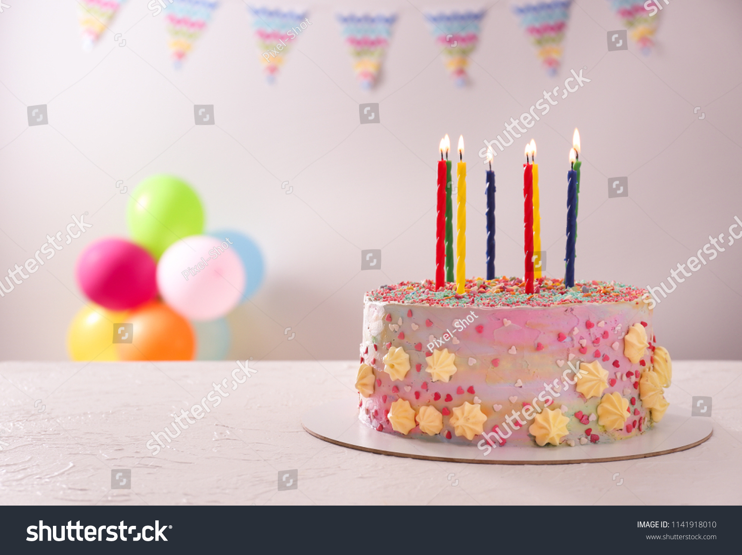 Beautiful Tasty Birthday Cake With Candles On White Table