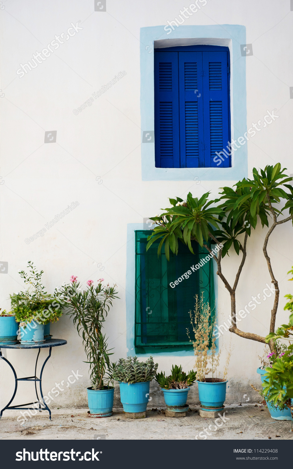 Traditional Greek House wall with colored windows from a traditional greek house stock
