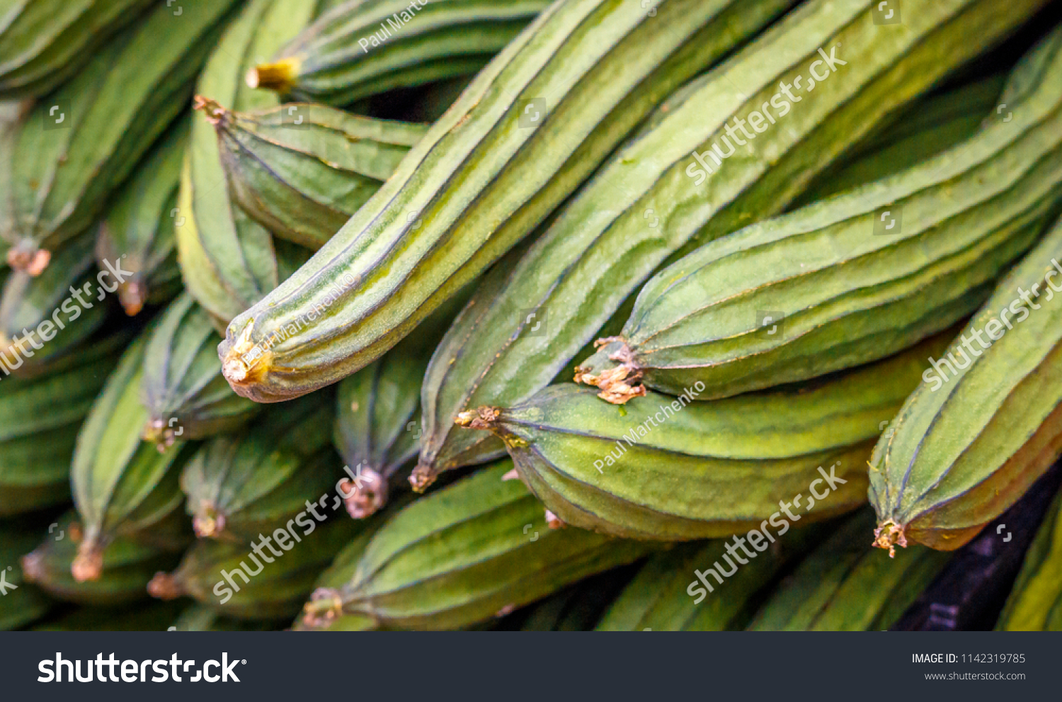 Chinese okra sqush bunched together #1142319785