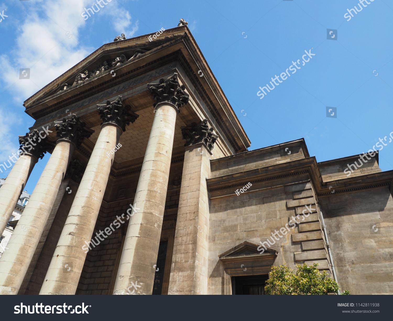 PARIS, FRANCE - JULY 10, 2018: Christian church Notre-Dame de Lorette, masterpiece of architect Hippolyte Lebas, soars into blue sky on July 10, 2018 in Paris, France.