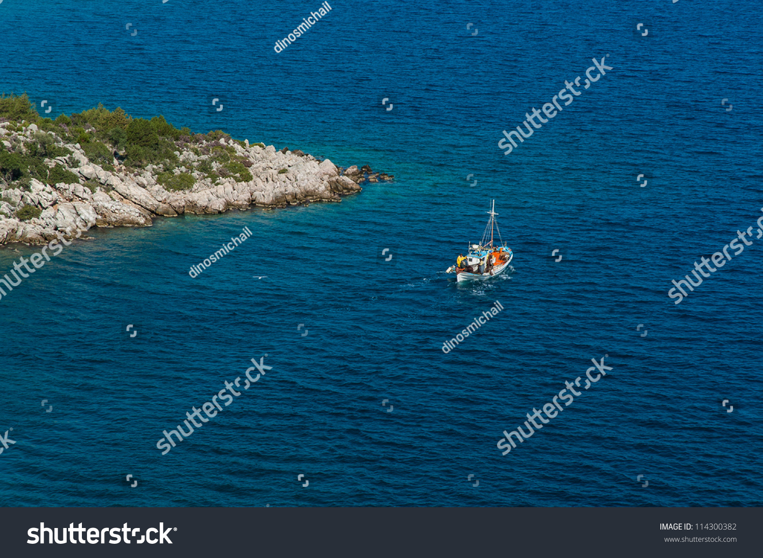 Traditional fishing boat near promontory greece stock for Where to get a fishing license near me