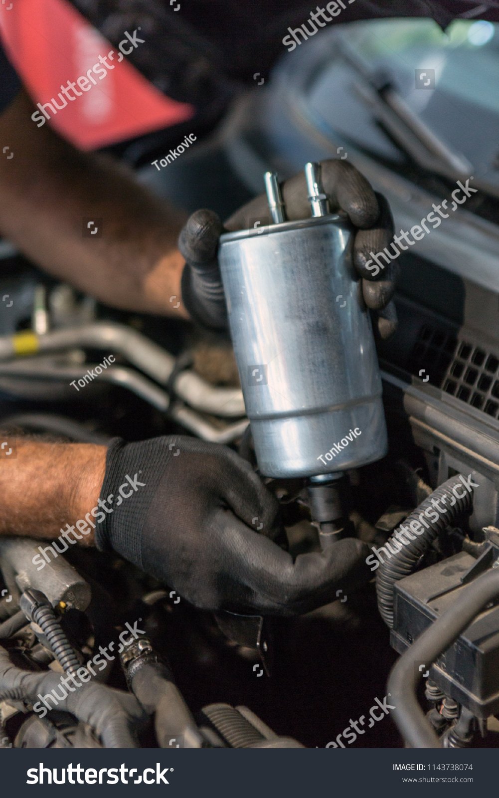 Mechanic Holding Fuel Filter Over Car Stock Photo Edit Now A The Hood Auto Repairing Or Servicing Concept