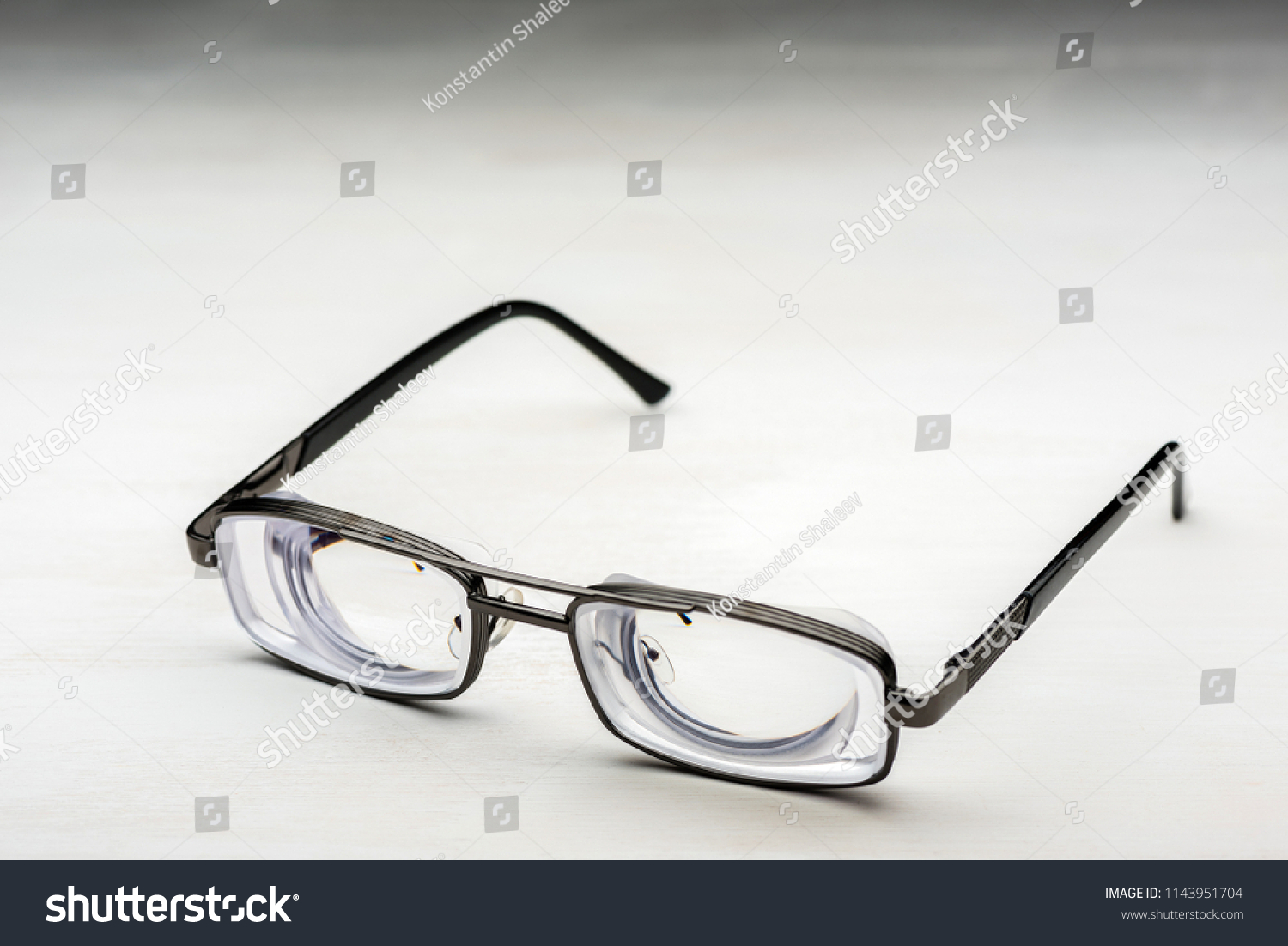 528537fa5a Very strong glasses with thick lenticular lenses in metal frame for high  myopia and poor eyesight
